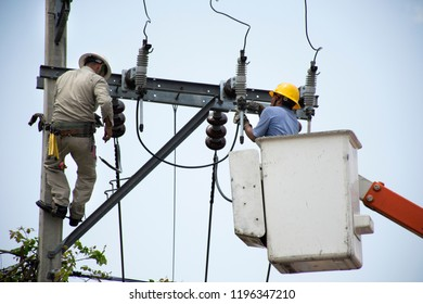 BANGKOK,THAILAND - APRIL 21 : Electrician worker of Metropolitan Electricity Authority working repair electrical system on electricity pillar or Utility pole on April 21, 2018 in Bangkok, Thailand