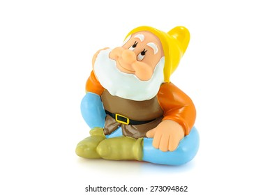 Bangkok,Thailand - April 26, 2015: .Happy figure toy is one of the seven dwarfs. The character appeared in Disney's Snow White and the Seven Dwarfs.