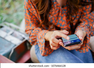 Bangkok,Thailand- April 7,2018 : close up woman hand holding smartphone (Iphone X) and show facebook application on screen , social median and technology concept