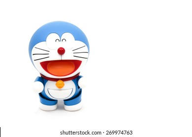 Bangkok,Thailand - APRIL 9, 2015: Figure of Doraemon animation is standing on white background on April 9, 2015 in Bangkok, Thailand. Doraemon animation series is very famous around the world.