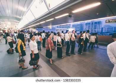 BANGKOK,THAILAND - APRIL,24 7 2009: people queuinto take the train at the  BTS elevated railway and MRT underground railway at Asok junction in the Thai capital.