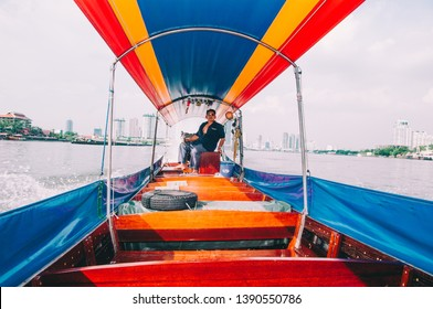 BANGKOK,THAILAND - APRIL,28,2009:Thai Driver is  on the Colourful long tail boats.