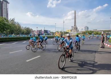"BANGKOK,THAILAND, AUG 16-2015 : Cyclists riding through Victory Monument in ""Bike for Mom"" event. These event show respected to Queen and set new Guinness World record."