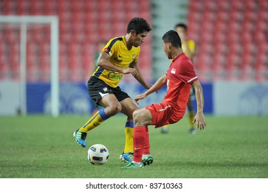 BANGKOK,THAILAND - AUG 24  ; Surat sukha of Thailand during friendly football match between Thailand (Y) and Singpore (R) at Rajamagala Stadium on Aug. 24, 2011  Bangkok Thailand