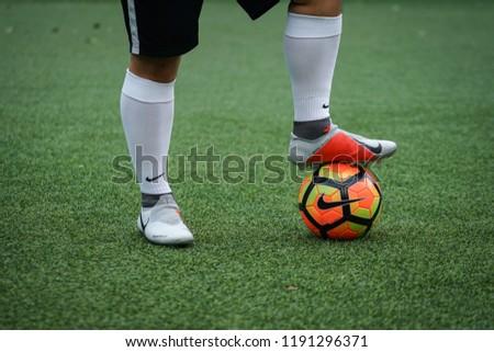 27c0038045f0 Bangkok/Thailand - August 2018: Football player is training on field with  Nike Phantom