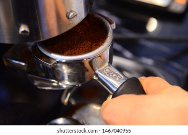 Bangkok,Thailand - August 26 ,2018 - Barista making coffee with Lamarzocco espresso machine