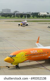 "Bangkok,Thailand - August 4, 2017. Nok air Boeing 737-800 (HS-DBT) named ""Nok Budhnampetch"" has been pushed back to taxiway at Donmueang International Airport."