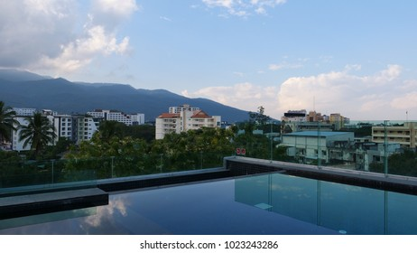 BANGKOK,THAILAND - CIRCA December 2017 :Infinity pool rooftop view of doi suthep mountain