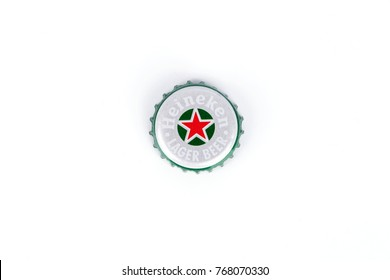 Bangkok,Thailand - December 03,2017 : heineken beer lid on white background ,Heineken is a world famous brand.