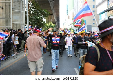 BANGKOK,THAILAND - DECEMBER 20: Parade of Anti-government protesters past Silom road. The protest Against The Amnesty bill in Bangkok, capital of Thailand on 20 December 2013