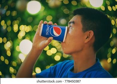 Bangkok,Thailand - December ,2017 : Unidentified man drinking Pepsi cup