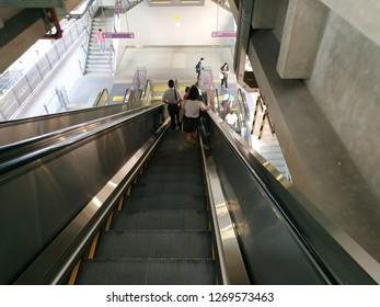 Bangkok,Thailand - December 21, 2018: Escalator stairs in MRT subway train station. Electric escalator take passengers up the MRT Purple Line Bang Yai-Tao Poon station. lifestyle of people in Bangkok.