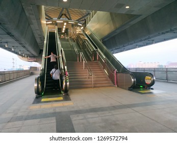 Bangkok,Thailand - December 26, 2018: Escalator stairs in MRT subway train station. Electric escalator take passengers up the MRT Purple Line Bang Yai-Tao Poon station. lifestyle of people in Bangkok.