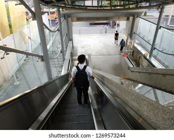 Bangkok,Thailand - December 27, 2018: Escalator stairs in MRT subway train station. Electric escalator take passengers up the MRT Purple Line Bang Yai-Tao Poon station. lifestyle of people in Bangkok.