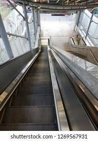 Bangkok,Thailand - December 28, 2018: Escalator stairs in MRT subway train station. Electric escalator take passengers up the MRT Purple Line Bang Yai-Tao Poon station. lifestyle of people in Bangkok.