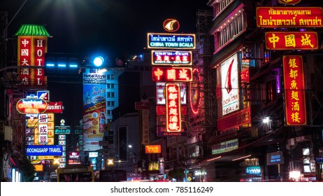 BANGKOK-THAILAND - DECEMBER 30, 2017 : Cars, shops, Street food, Night Market and neon light signs  on Yaowarat road at night in a large Chinese community in Bangkok, CHINATOWN.