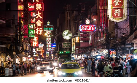 BANGKOK-THAILAND - DECEMBER 30, 2017 : Street food in Chinatown and neon light signs and cars on Yaowarat road at night in a large Chinese community in Bangkok, CHINATOWN.