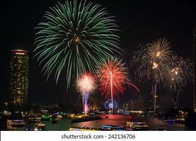 Bangkok,Thailand - December 31,2014 : The happy new year 2015 exploding fireworks over chaophraya river  in Bangkok,Thailand.