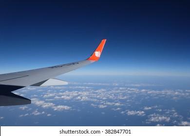 BANGKOK,THAILAND- FEB 22, 2016 : .Boeing 737-800 Thai-lion Air flight No. SL 8749  before landing with beautiful sky