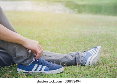 BangkokThailand - Feb 26 2017 : young man sitting with adidas neo shoes on green grass