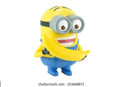 Bangkok,Thailand - February 17, 2014: Minion Dave Minion Dave with yellow banana figure toy character from Despicable Me 2 movie. There are plastic toy sold as part of the McDonald's Happy meals.