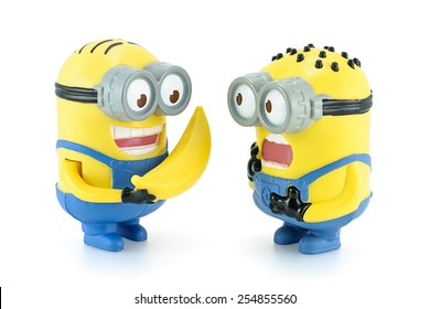 Bangkok,Thailand - February 17, 2014: Minion Dave give banana to Minion figure toy character from Despicable Me 2 movie. There are plastic toy sold as part of the McDonald's Happy meals.