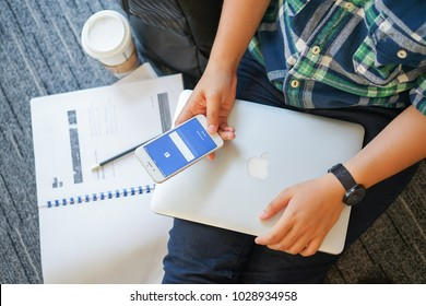 Bangkok-Thailand February 17 2018 :close up teenager woman hand holding smart mobile phone and typing keyboard on touchscreen for log in or sign up facebook application.social media addiction concept