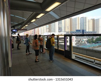 Bangkok,Thailand - February 18, 2019: People passenger wearing face mask for protection against the air pollution at MRT Purple Line Bang Yai-Tao Poon station. lifestyle of people in Bangkok, Thailand