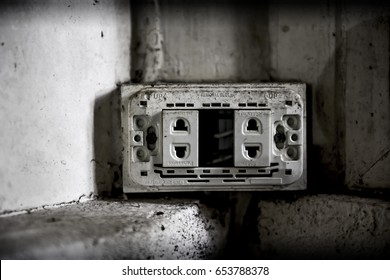 BANGKOK,THAILAND - FEBRUARY 19,2017: A broken old socket outlet  in the corner of Unidentified abandoned building.
