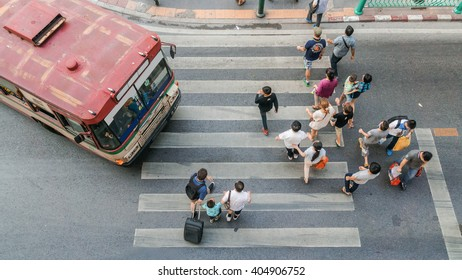 Bangkok,THAILAND - February 20, 2016.People are walking across road before the bus is going to stop at the crosswalk in top view. Bangkok, Thailand.