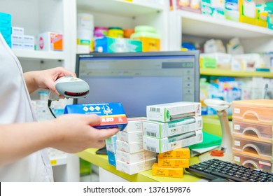 Bangkok,Thailand - February 23,2019: Pharmacist scanning barcode of medicine drug in a pharmacy drugstore , Thai pharmaceutical market grows at an average rate of 5-6% per year.