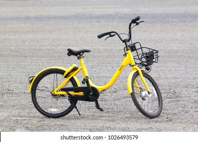 Bangkok,Thailand - February 3, 2018 : Ofo bikes parked in the parking lot. Ofo is a bike-sharing service provider.