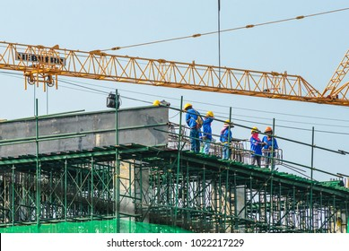 Bangkok,Thailand - February 9,2018: Workers working on a building under construction on the site.