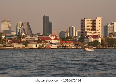 BANGKOK/THAILAND - JAN 26 2019: Bangkok Modern and Traditional Vintage Building Skyline Cityscape View with Chao Phraya River and Public Boat Transportation