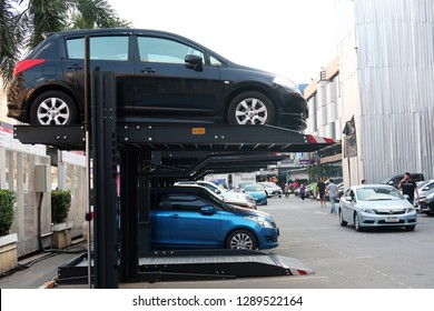 Bangkok/Thailand - January 17,2019 : Automated 2 levels car parking lift system, to double parking space in city.