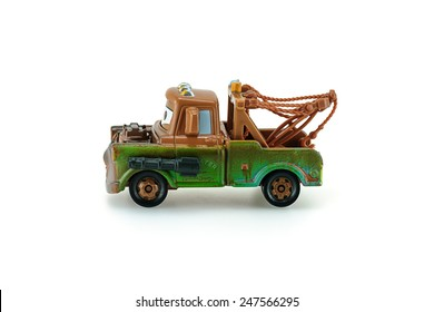 Bangkok,Thailand - January 26, 2015: Tow Mater pick-up truck with machine gun a main protagonist of the Disney Pixar feature film Cars. A diecast cars collection from mattel inc.