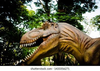 "Bangkok,Thailand - January 27, 2019 : Big model of prehistoric dinosaur, Dinosaur replica sculpture within the event ""Thailand Tourism Festival 2019"" at Lumpini Park. Realistic scenery."