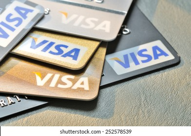 BANGKOK,THAILAND - January 28,2015:  Visa credit cards on leather board.