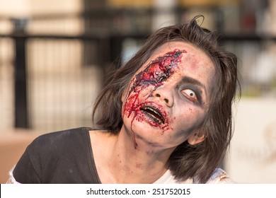 "BANGKOK,THAILAND - JANUARY 8, 2015: Unknown Thai girl participates in ""FOX Thai The Walking Dead Season 5 Marathon"" dressed as zombies"