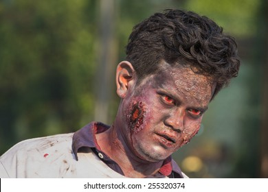 "BANGKOK,THAILAND - JANUARY 8, 2015: Unknown Thai guy participates in ""FOX Thai The Walking Dead Season 5 Marathon"" dressed as zombies"