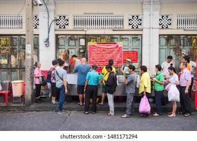 Bangkok-Thailand JUL 30 2019: Unidentified people standing to buy street food, Jek Pui Curry rice store is a famous and is also a check in point that shouldn't be missed on Chinatown (Yaowarat)