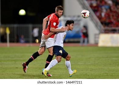 BANGKOK,THAILAND- JULY 13: Michael Carrick (Red) in action during football friendly match between Singha All-Star vs Manchester United at Rajamangala stadium on July 13, 2013; Bangkok,Thailand
