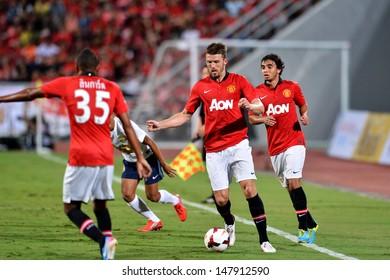 BANGKOK,THAILAND- JULY 13: Michael Carrick (Center) in action during football friendly match between Singha All-Star vs Manchester United at Rajamangala stadium on July 13, 2013; Bangkok,Thailand