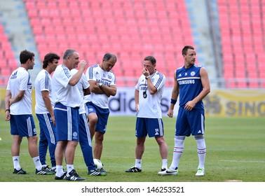 BANGKOK,THAILAND- JULY 16: John Terry (R) during a Chelsea FC training session at Rajamangala Stadium on July 16, 2013 in Bangkok, Thailand.
