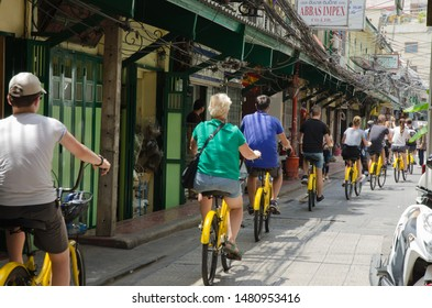 Bangkok,Thailand - July 2019: Tourist riding Ofo Bicycles for travel in middle capital at Yaowarat  in Bangkok,Thailand.