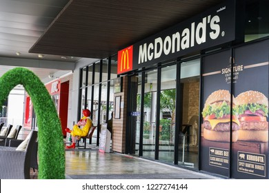 BANGKOK,THAILAND - July 23, 2018 :  In front of  McDonald's restaurant and back side of Ronald McDonald statue
