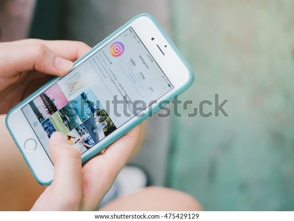 BANGKOK,THAILAND - July 24,2016: Woman hand holding Apple iPhone with Instagram application on the screen. Instagram is a photo-sharing app for smartphones.
