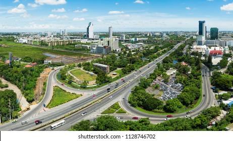Bangkok,Thailand - July 5 2018 : Trafic and road with Bangkok skyscaper and High rise business building on Bang na - Trad to Chonburi Province.