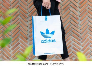 c4a3b2b772 BANGKOK,THAILAND - JULY 7,2018:A woman holding paper bag Adidas original