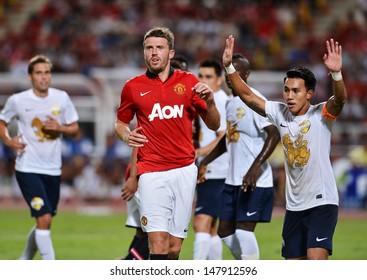 BANGKOK,THAILAND- JULY13: Michael Carrick (Red) of Manchester United during football friendly match between Singha All-Star vs Manchester United at Rajamangala stadium on July13,2013; Bangkok,Thailand